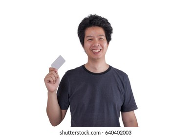 Adult Asian man wearing casual cloths smiling while holding blank credit card isolated on white background