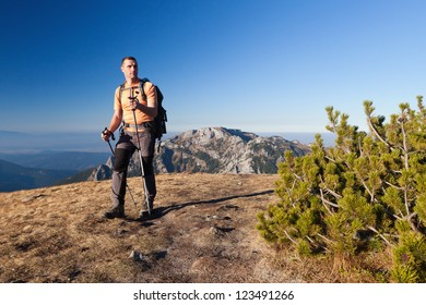 Adult backpaker at Ornak Peak in Tatra Mountains, Poland