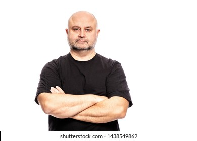 Adult bald man with arms crossed. Isolated on a white background.