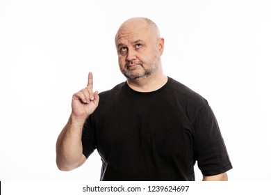 Adult bald man, forefinger in, attention