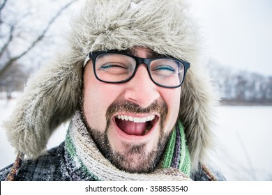Adult bearded man with glasses and a winter hat