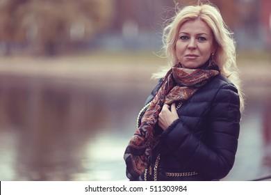 adult blond woman in autumn park