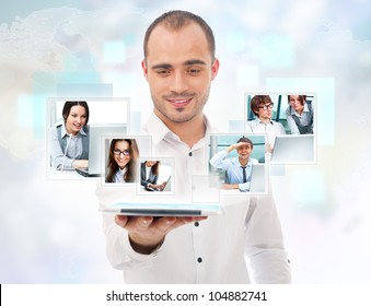 Adult businessman using his tablet computer to communicate his team. Virtual meeting technology for global business concept.