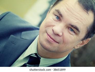 adult businessman wear business suit, crossprocessed
