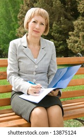Adult businesswoman outdoors