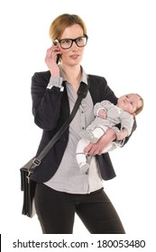 Adult businesswoman Woman wearing shirt and jacket and has a baby in her arms while using a mobile phone, isolated against a white background.
