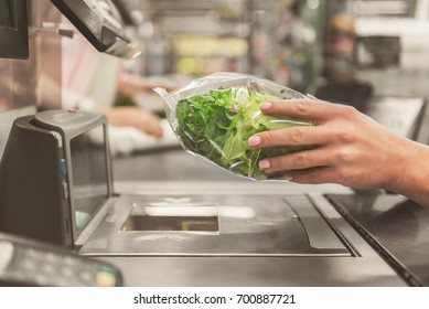Adult cashier lady working in supermarket