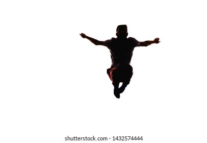 Adult caucasian male jumping while dancing. Image is isolated on a white background