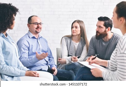 Adult caucasian man asking for advice, sharing his family problems at group session, empty space