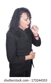 adult caucasian woman in black clothes and jacket with red lips and mails coughing with hand in front of her mouth