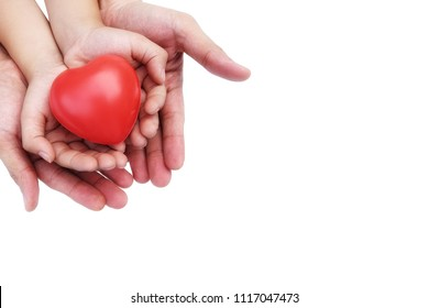 Adult and Child Hand holding Red Heart,Concept of Love and Health care,family insurance.World heart day, World health day.Valentine's day.isolated shape of heart on white background.