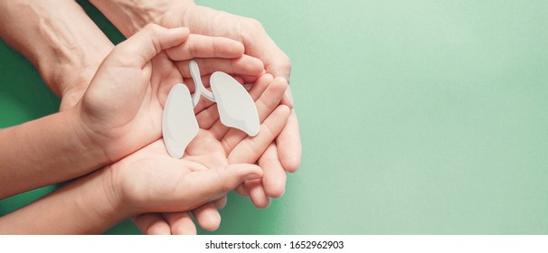 Adult and child hands holding lung, world tuberculosis day, world no tobacco day, lung cancer, coronavirus covid-19,  Pulmonary hypertension, Pneumonia, copd, eco air pollution,organ donation concept