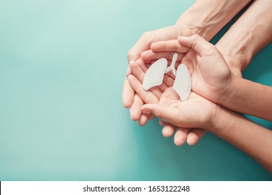 Adult and child hands holding lung, world tuberculosis day, world no tobacco day, lung cancer,  Pulmonary hypertension, Pneumonia, copd, eco air pollution,organ donation, healing concept