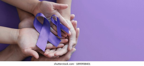 Adult and child hands holding purple ribbons, Alzheimer's disease, Pancreatic cancer, Epilepsy awareness, world cancer day on purple background