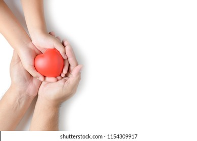 adult and child hands holding red heart isolated on white background, health care, love and family insurance concept, world heart day