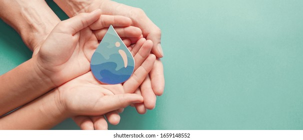 Adult and child hands holding water drop, world water day,  clean water and sanitation, hand sanitizer and hygiene for covid-19, family washing hands, CSR, save water, World Oceans Day concept