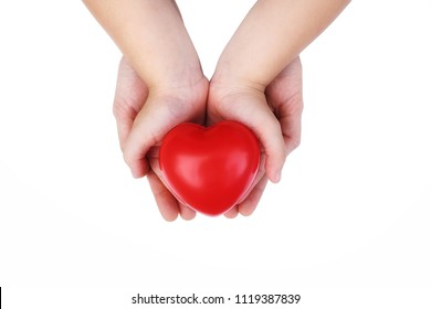 Adult and Child kid Hand holding Red Heart,Concept of Love and Health care,family insurance.World heart day, World health day.Valentine's day.isolated shape of heart on white background.