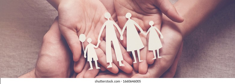 Adult and children hands holding paper family cutout, family home, adoption, foster care, homeless support, family mental health, autism support, domestic violence, social distancing concept