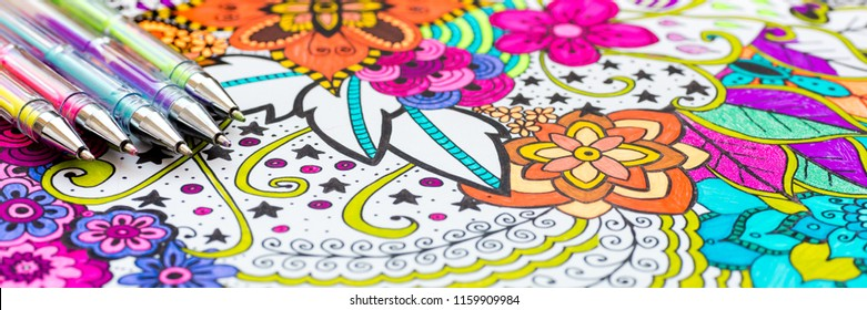Adult coloring book, new stress relieving trend. Art therapy, mental health, creativity and mindfulness concept. Web banner, panoramic close up shot.