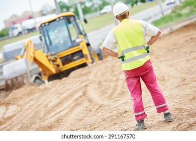 adult construction site manager worker at earthmoving roadwork