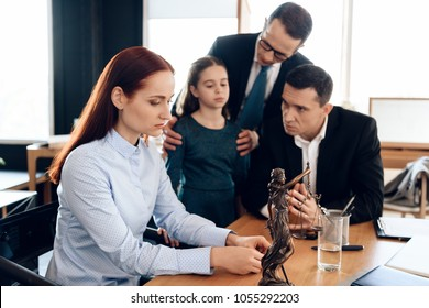 Adult couple decides who will be guardian of little girl in office of family lawyer. Family in office of family lawyer. Young man and beautiful woman decide who will be main guardian of little girl.