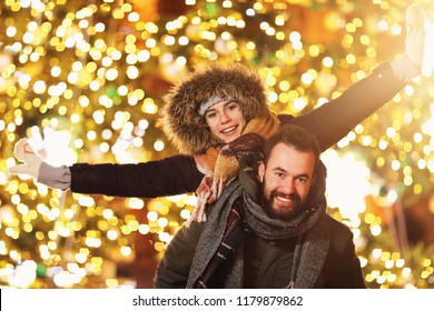 Adult couple hanging out in the city during Christmas time