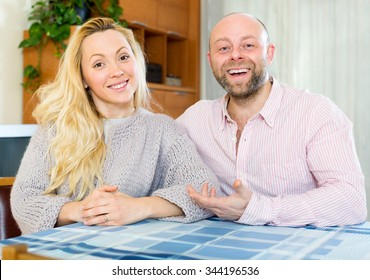 Adult couple in love at home in the living room