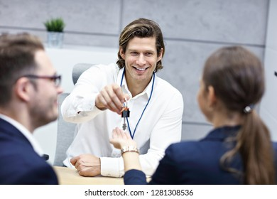 Adult couple in the office with real estate agent
