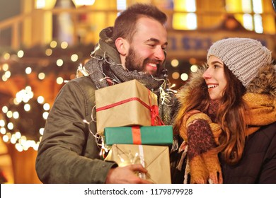 Adult couple shopping in the city during Christmas time