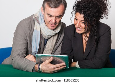 Adult Couple with Tablet PC