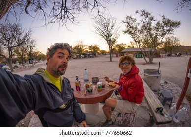 Adult couple taking selfie in the Namib desert, Namib Naukluft National Park, main travel destination in Namibia, Africa.