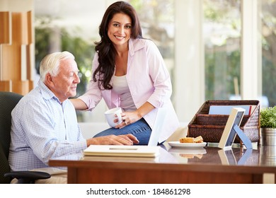 Adult Daughter Helping Father With Laptop
