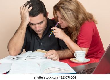 Adult education - Hispanic man and woman studying or doing office work at home
