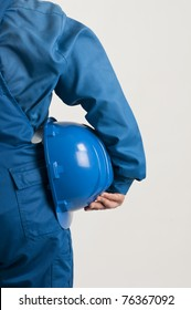 adult enginner holding a blue helmet