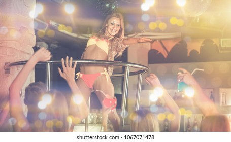 Adult english woman dancer gogo dancing in the night club on stage