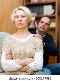 Adult family couple being reconciled after argue at house