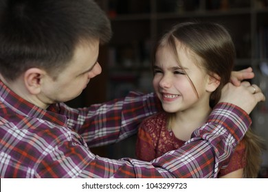 Adult father looking with love and tenderness on his princess, small daughter, family relationship concept, indoor portrait