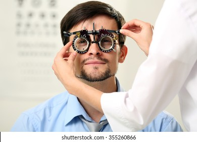 Adult female doctor examing adult male patient