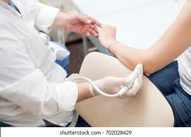 Adult female patient elbow joint ultrasound at private clinic.
