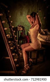 Adult fit slim woman in front of a mirror. Great posture of young woman.
