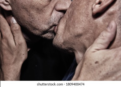 Adult gay couple and kiss.