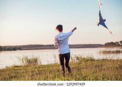 adult girl playing with a kite. Horizontal photo