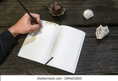 Adult hand ready to write down his projects
