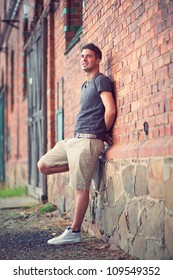 adult handsome man posing outdoor in a wall background