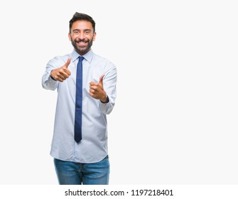 Adult hispanic business man over isolated background approving doing positive gesture with hand, thumbs up smiling and happy for success. Looking at the camera, winner gesture.