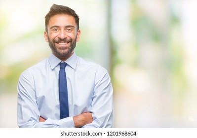 Adult hispanic business man over isolated background happy face smiling with crossed arms looking at the camera. Positive person.