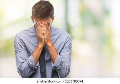 Adult hispanic business man over isolated background with sad expression covering face with hands while crying. Depression concept.