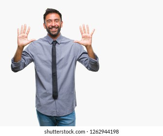 Adult hispanic business man over isolated background showing and pointing up with fingers number ten while smiling confident and happy.