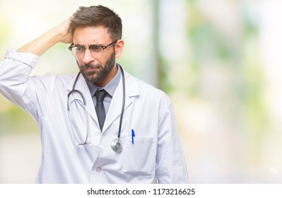 Adult hispanic doctor man over isolated background confuse and wonder about question. Uncertain with doubt, thinking with hand on head. Pensive concept.