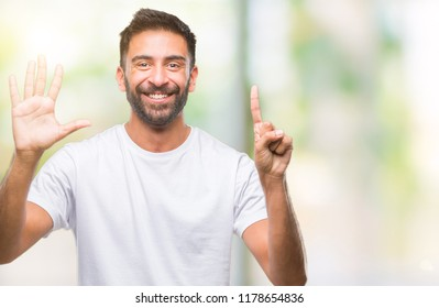 Adult hispanic man over isolated background showing and pointing up with fingers number six while smiling confident and happy.
